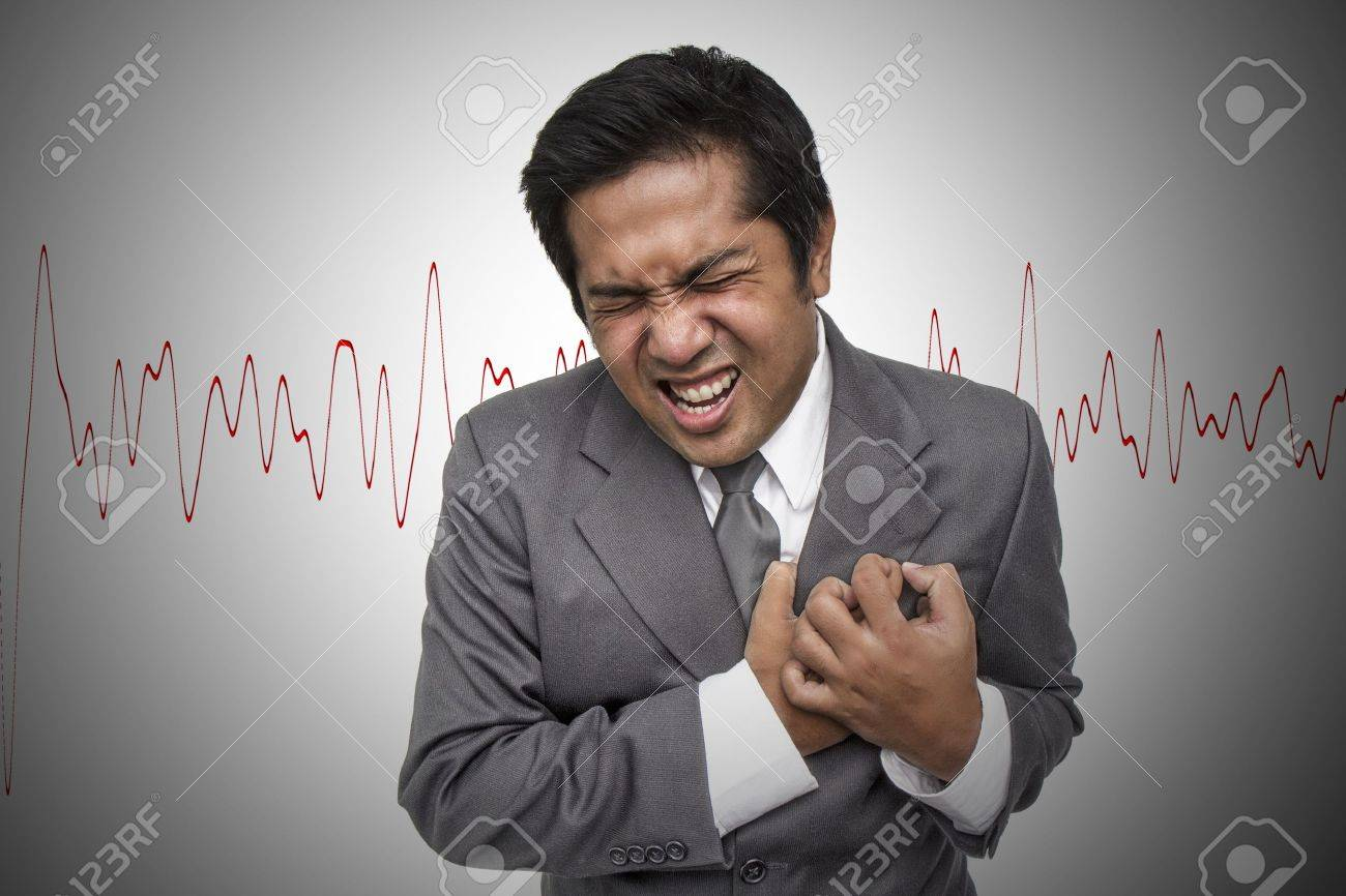 Young businessman having heart attack Stock Photo - 14938142