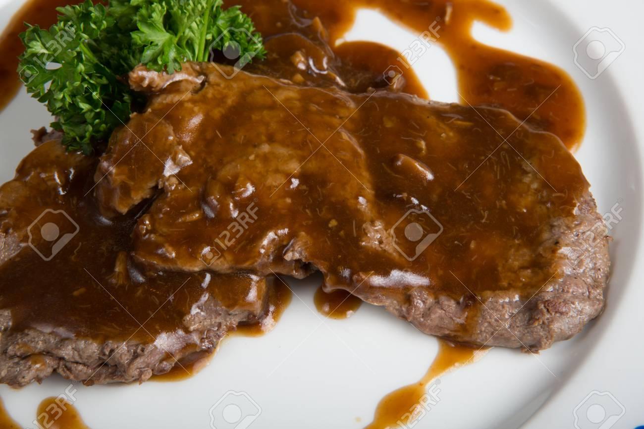 Asian style beef steak with gravy sauce Stock Photo - 57445881