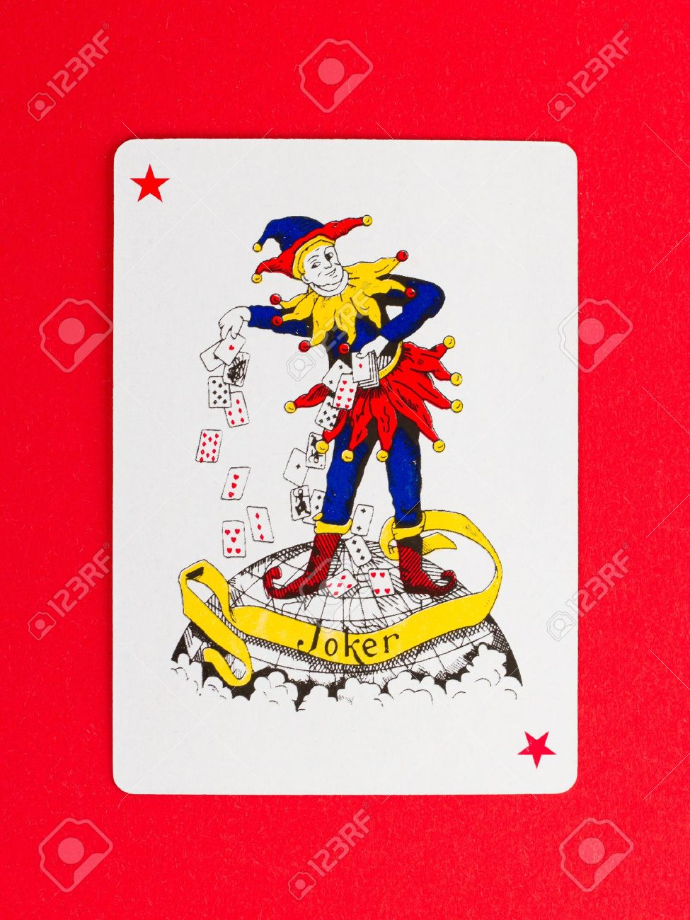 Playing card (joker) isolated on a red background Stock Photo - 13652028