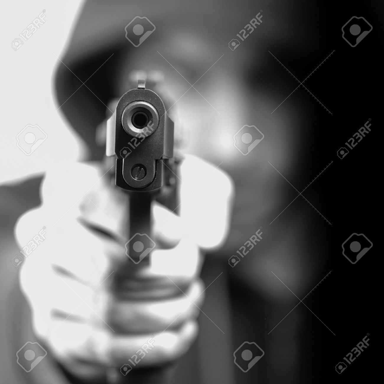 Man with gun, gangster, focus on the gun Stock Photo - 13661207