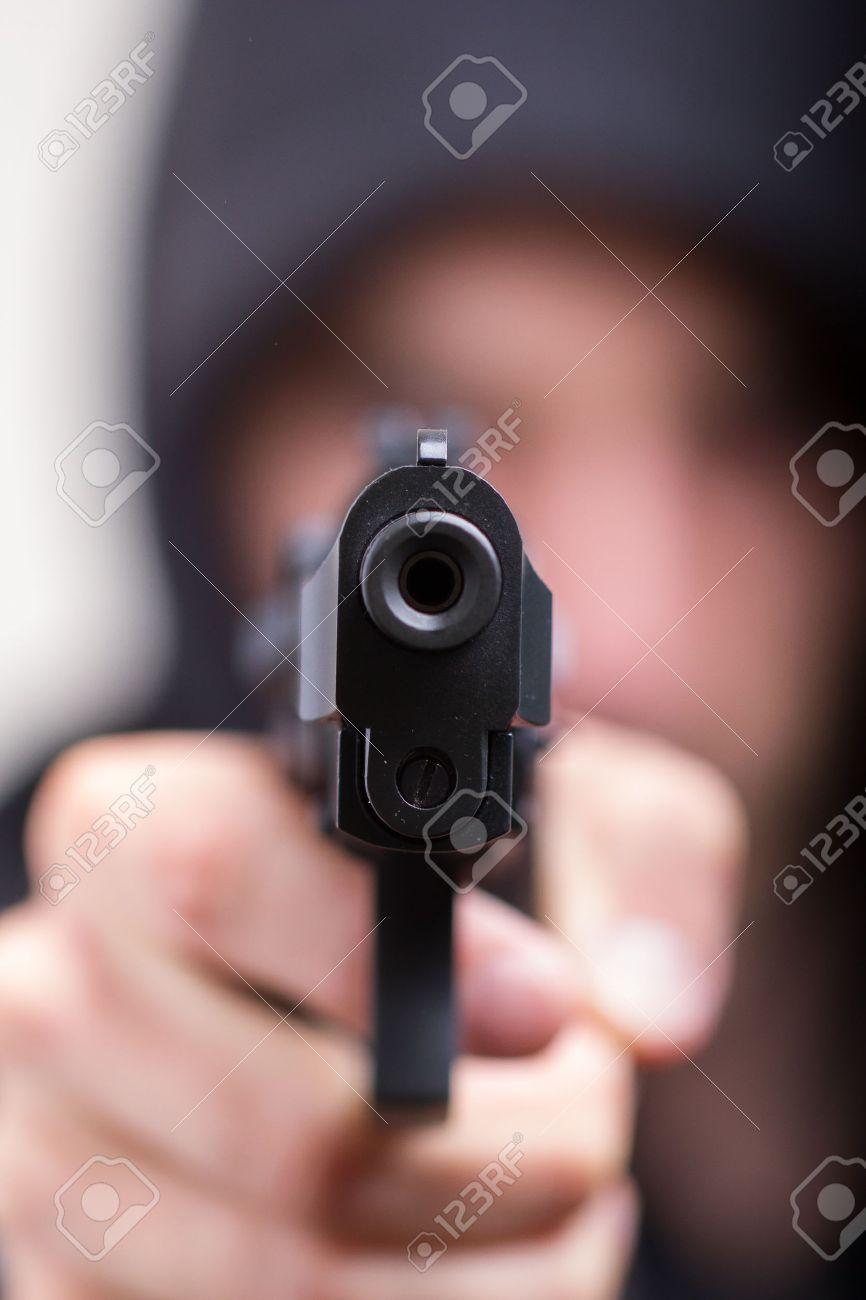 Man with gun, gangster, focus on the gun Stock Photo - 13661273