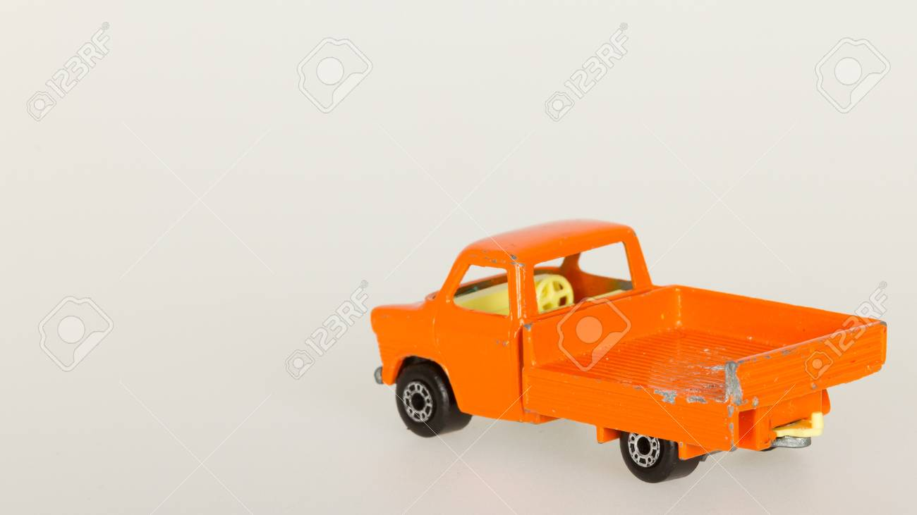Very old toy car with room for text(pick-up, 1970) isolated on white Stock Photo - 14429985