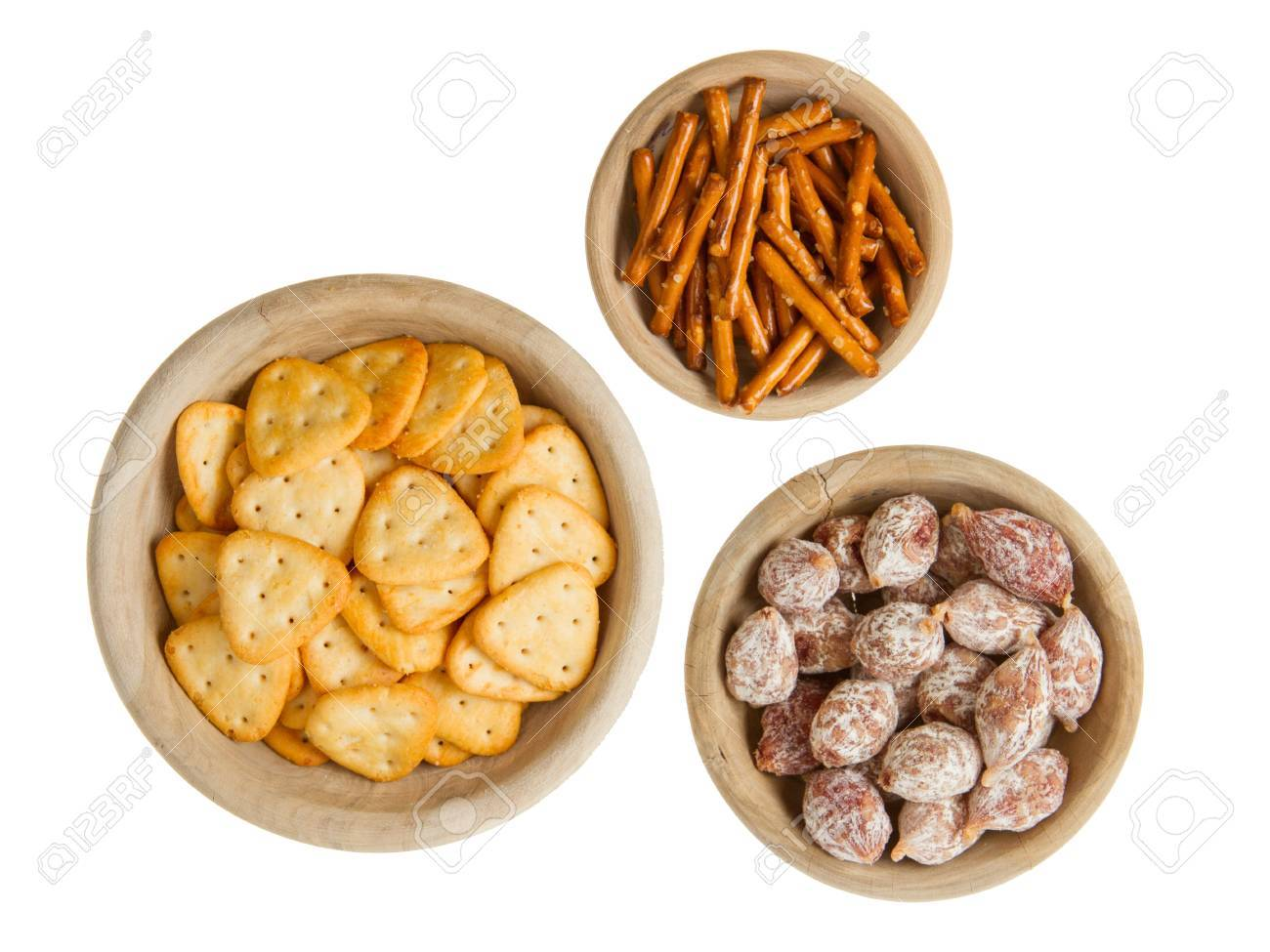 Italian salami and typical dutch salty snacks in wooden bowl, isolated on white Stock Photo - 14430361