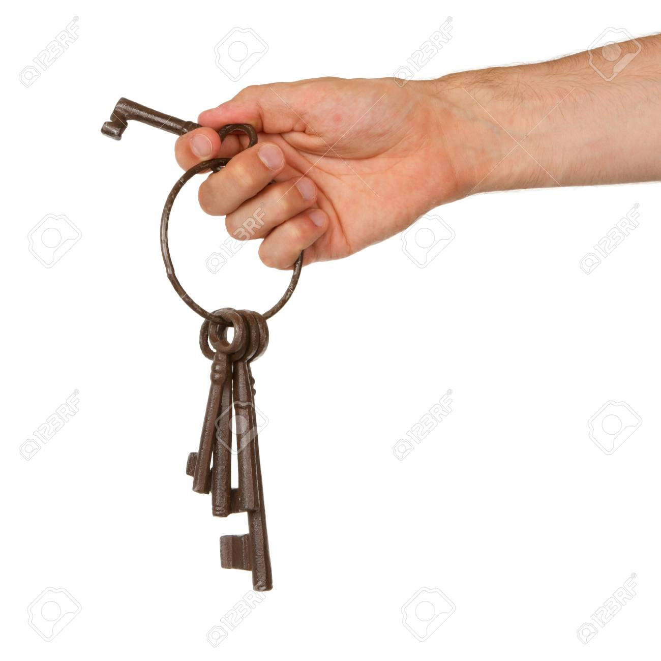 Old rusty bunch of keys in hand, isolated on white Stock Photo - 14431239