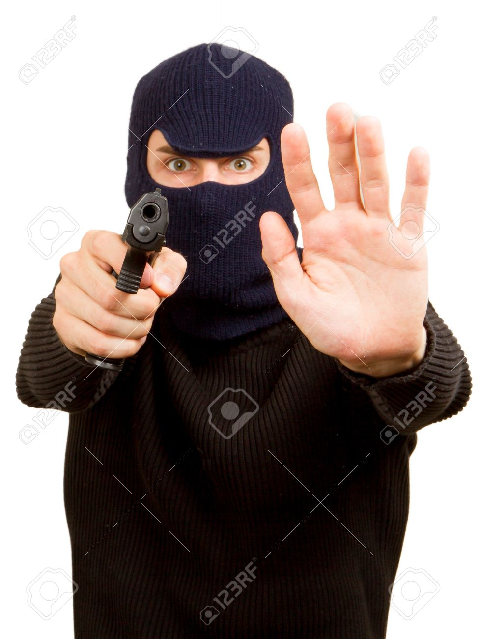 Photo of terrorist with gun attacking someone while pointing it forwards Stock Photo - 14524939