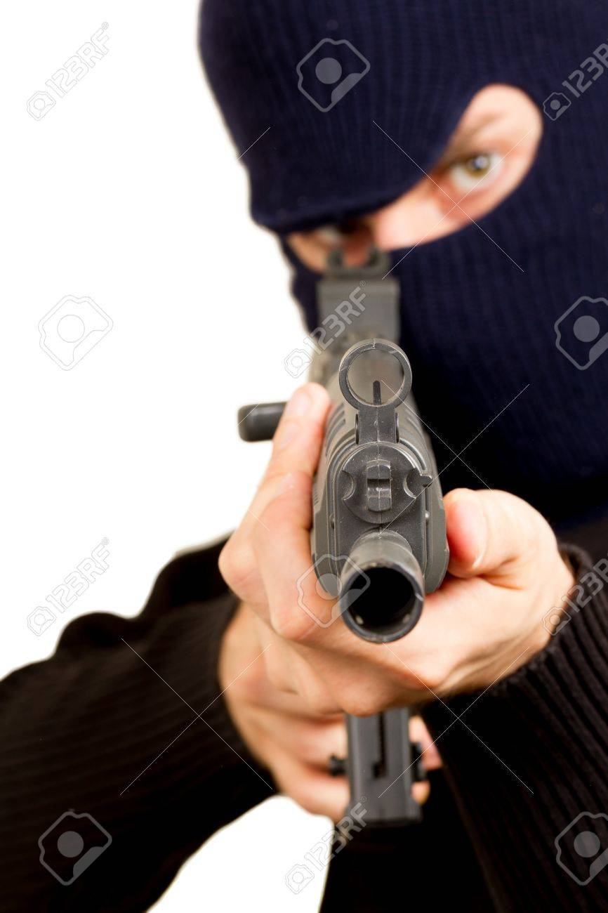 Photo of terrorist with gun attacking someone while pointing it forwards Stock Photo - 14524953