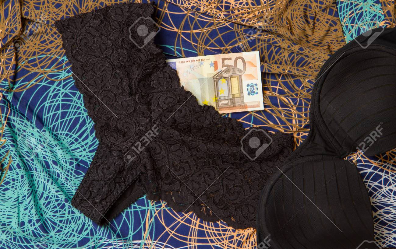 Euros and black underwear with dress isolated Stock Photo - 15600419