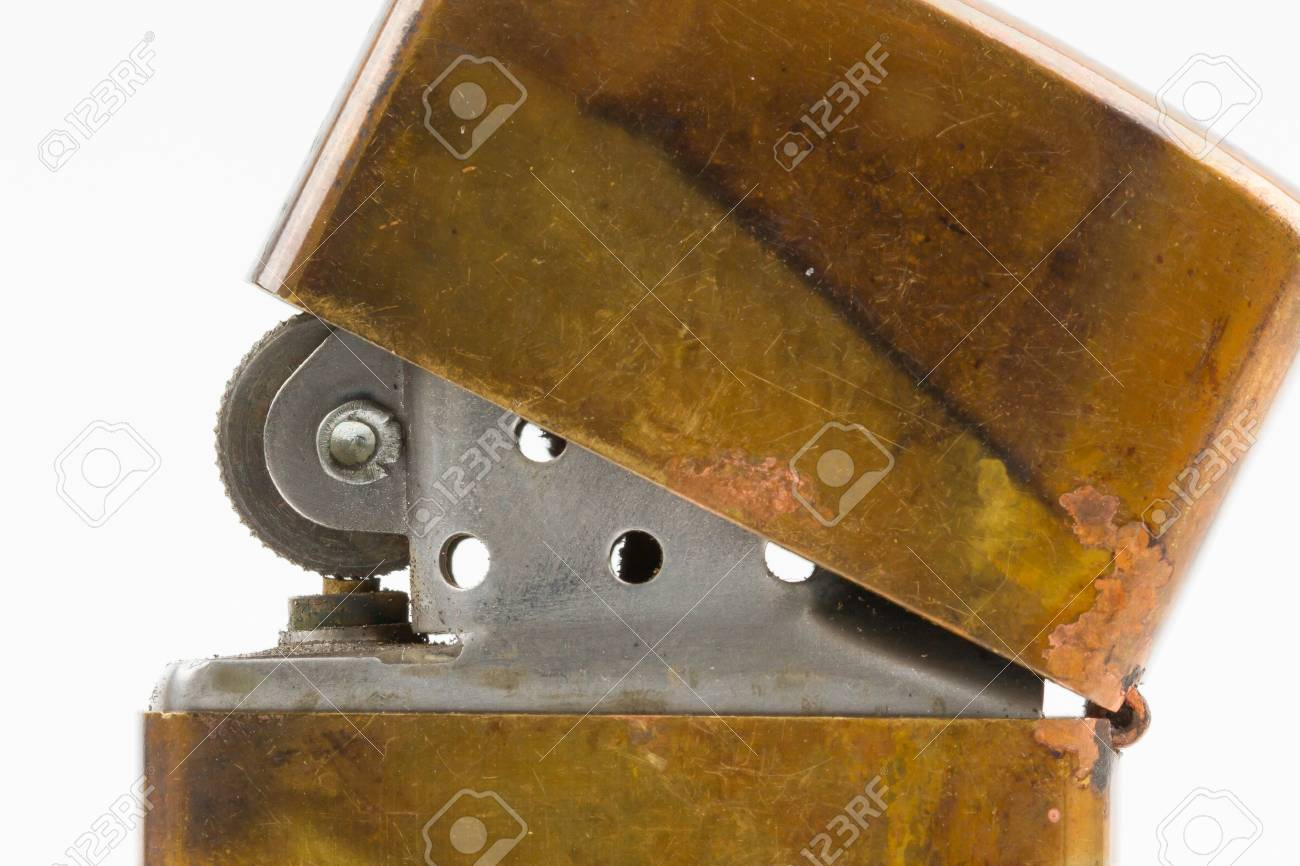 Very old lighter on a white background Stock Photo - 15612120