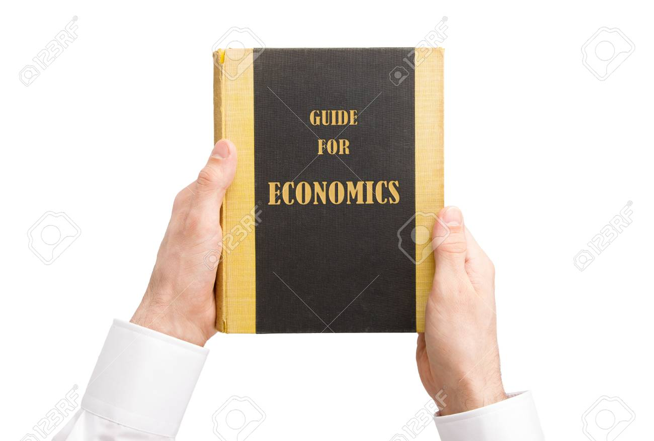 Businessman holding an old book, guide for economics Stock Photo - 17272647