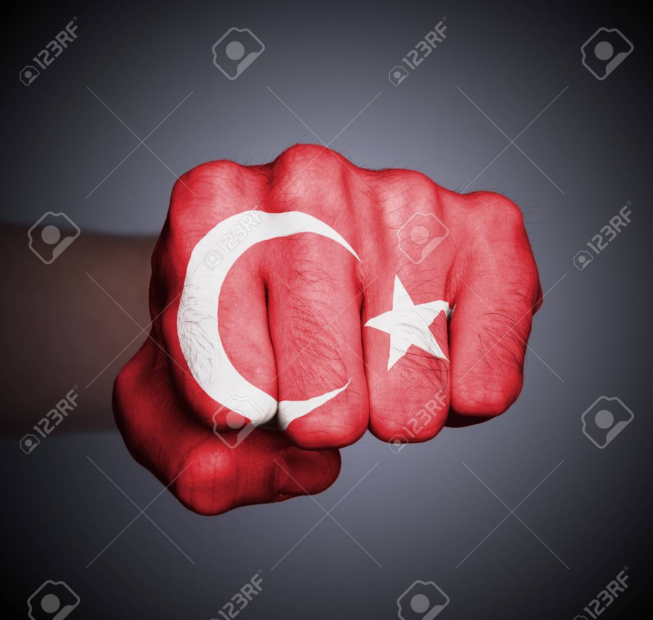 Front view of punching fist on gray background, flag of Turkey Stock Photo - 17387796