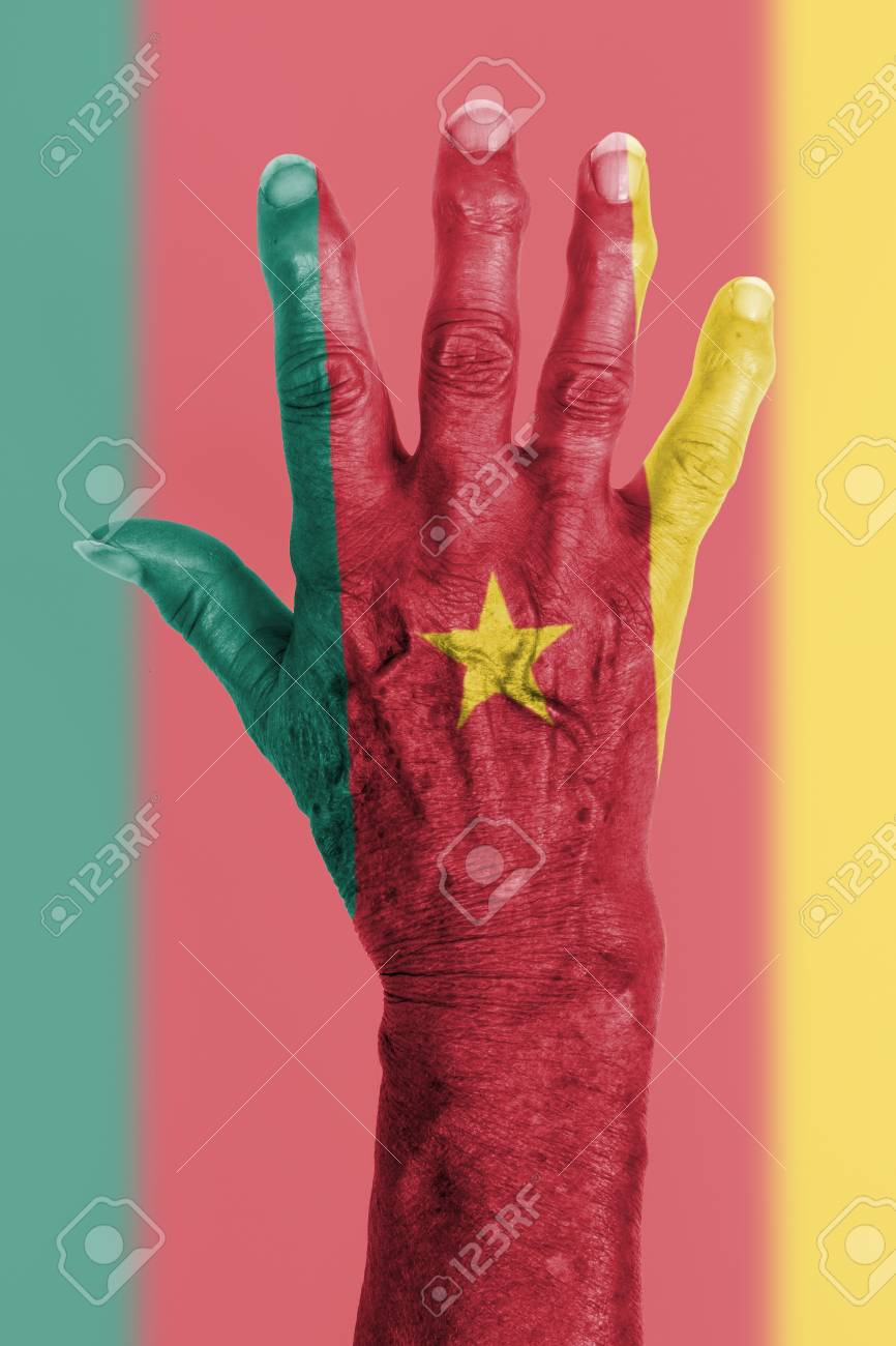 Hand of an old woman with arthritis isolated on white cameroon stock photo