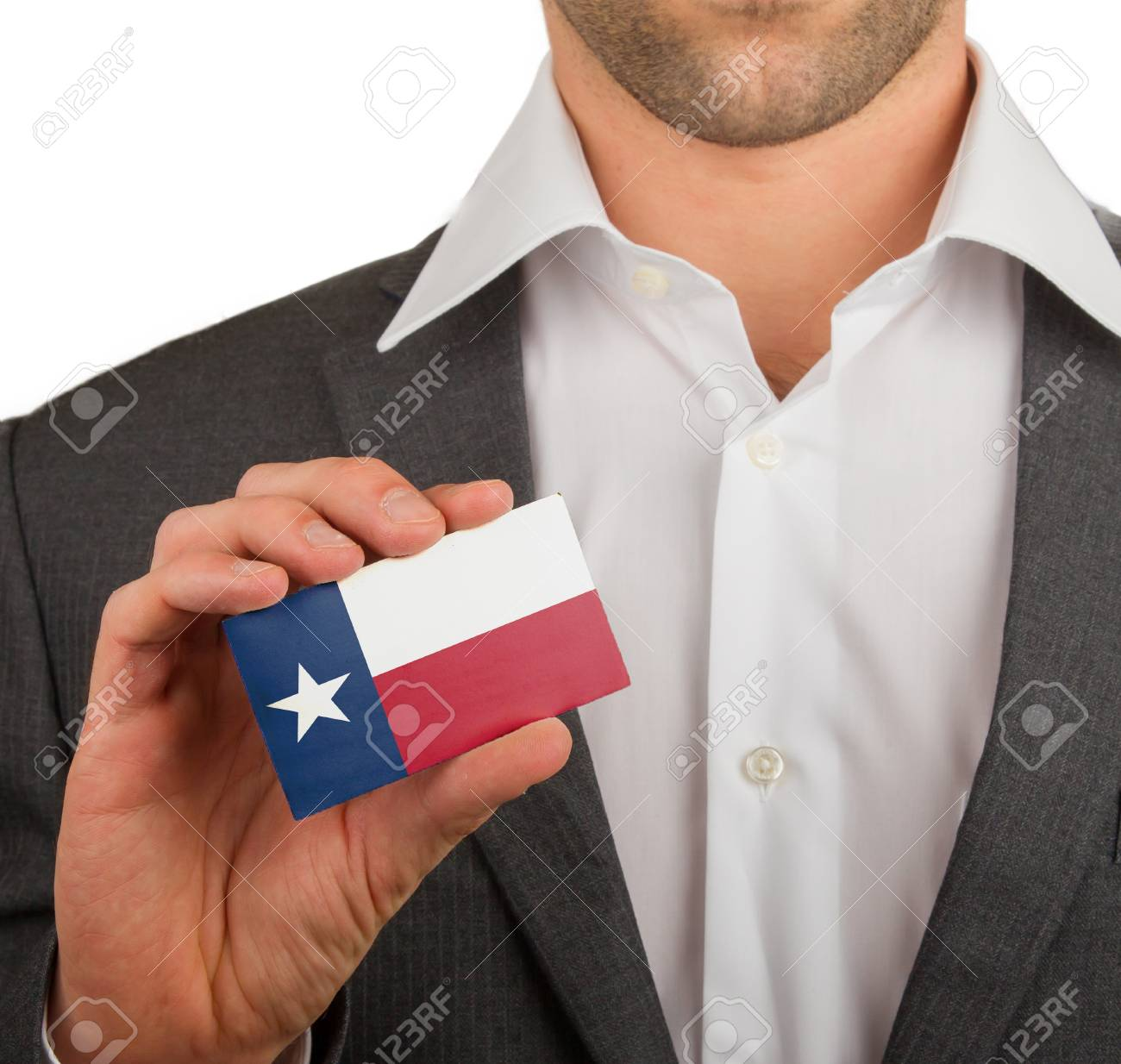 Businessman is holding a business card, flag of Texas Stock Photo - 18031074