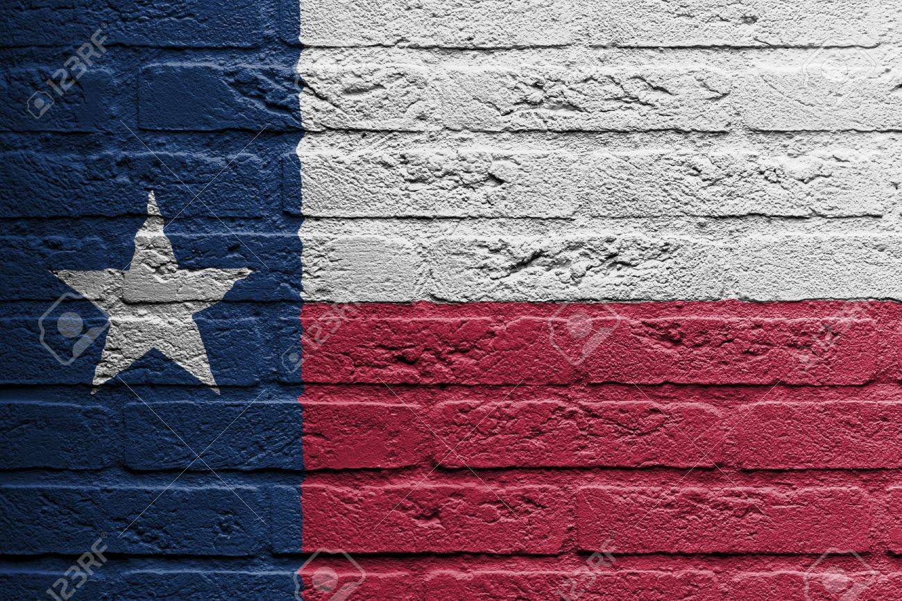 Brick wall with a painting of a flag isolated, Texas Stock Photo - 18050677