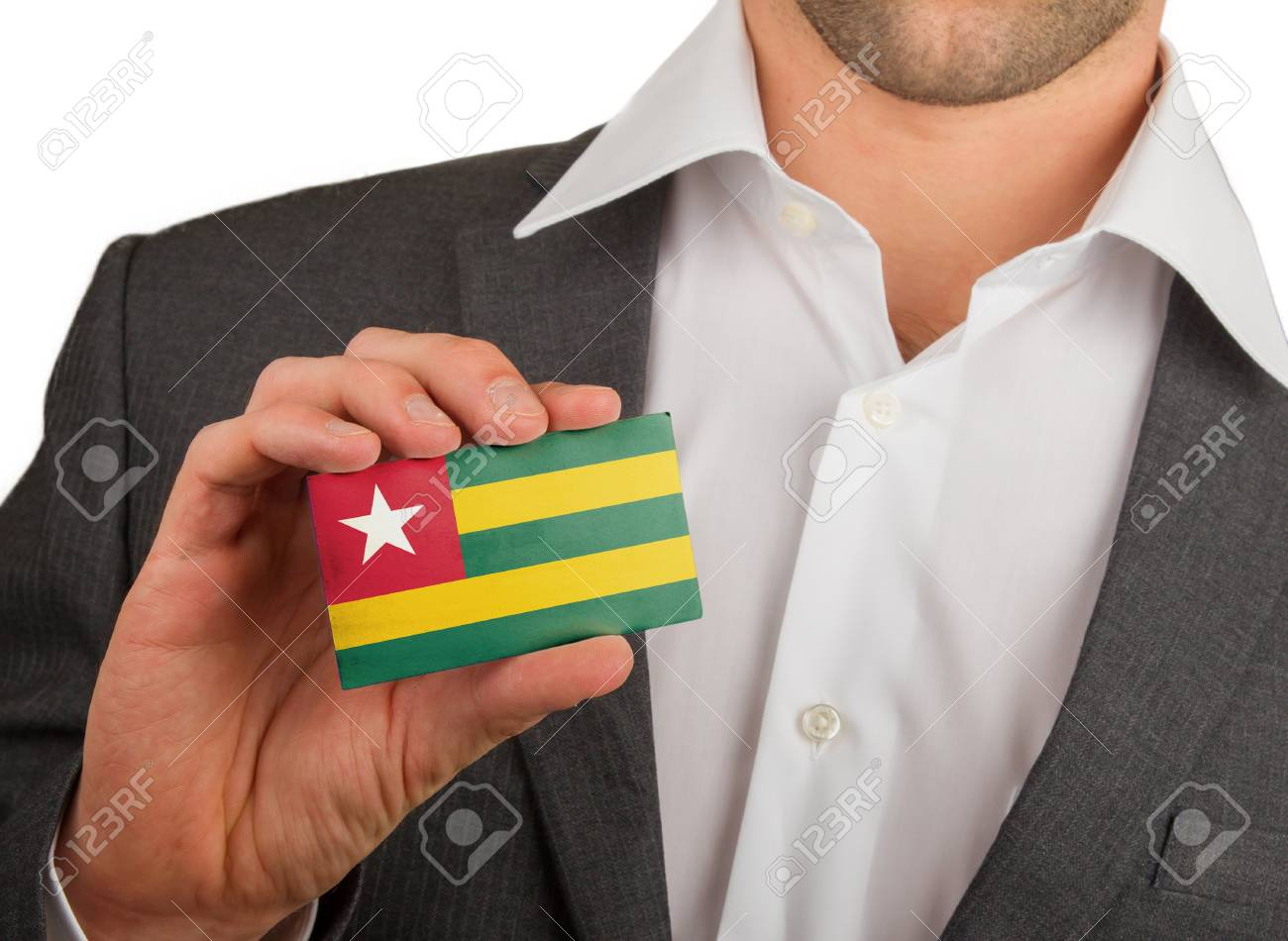 Businessman is holding a business card, flag of Togo Stock Photo - 18165436