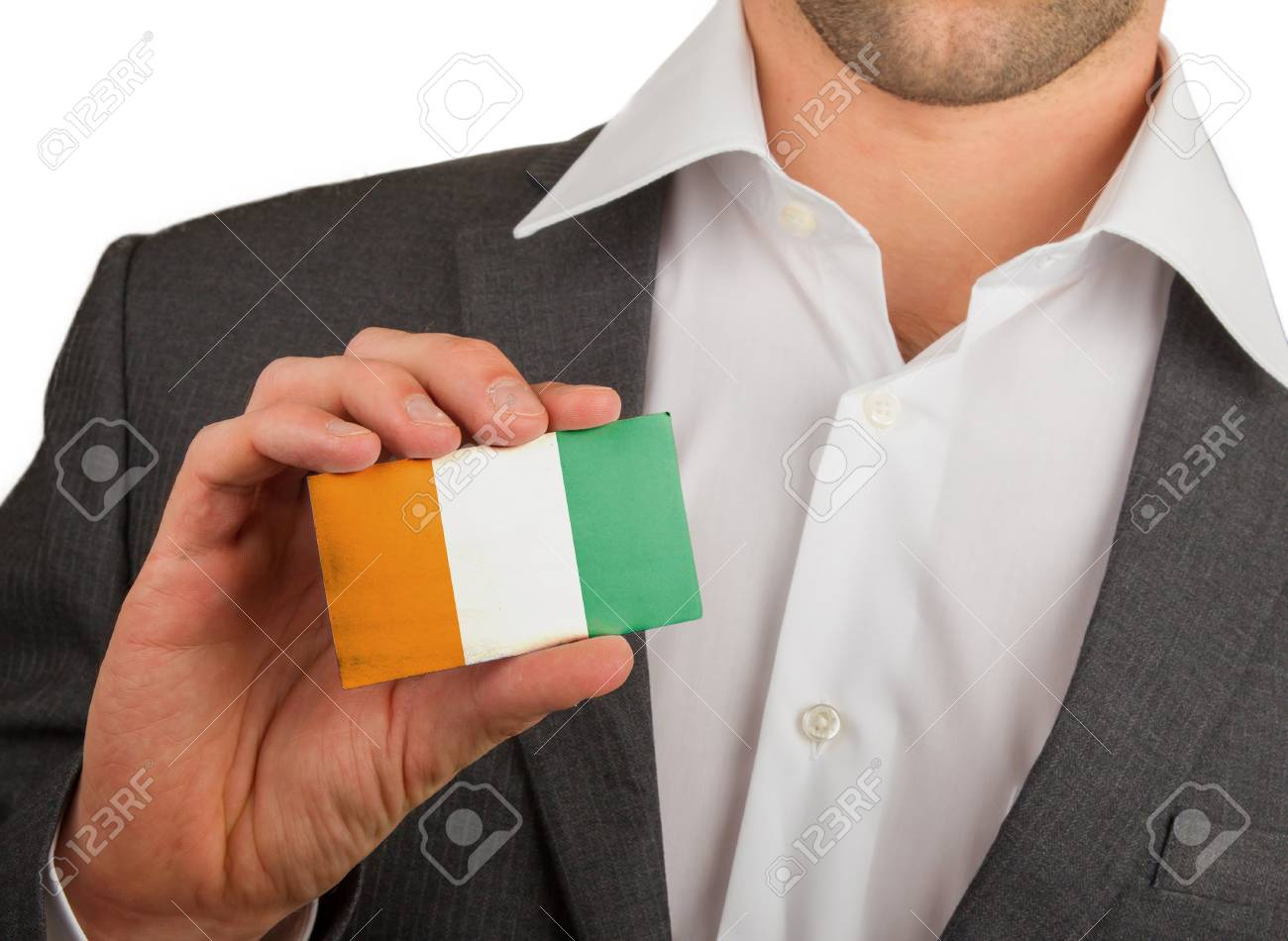 Businessman is holding a business card, flag of Cote d'Ivore Stock Photo - 18213470