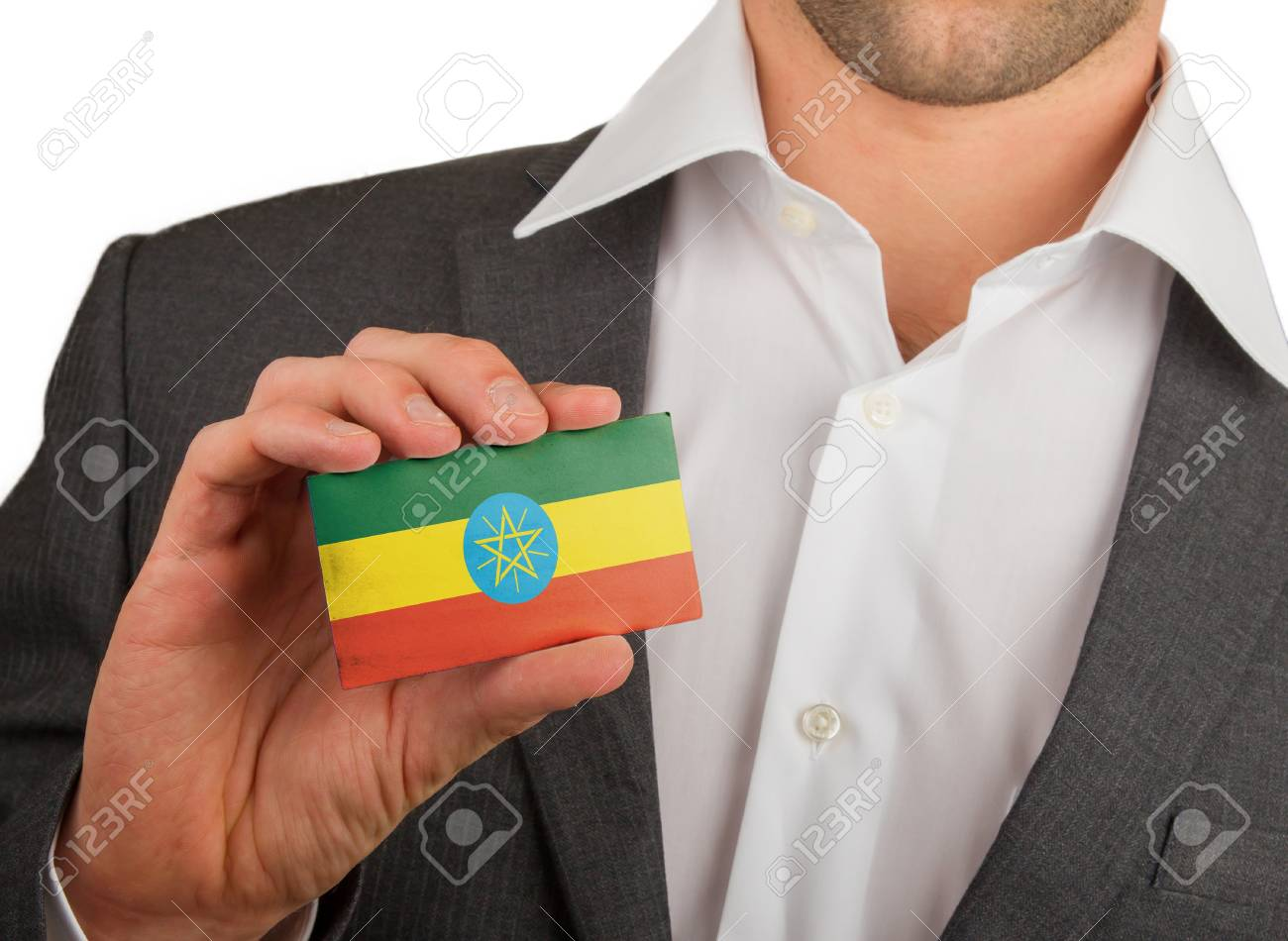Businessman is holding a business card, flag of Ethiopia Stock Photo - 18213484