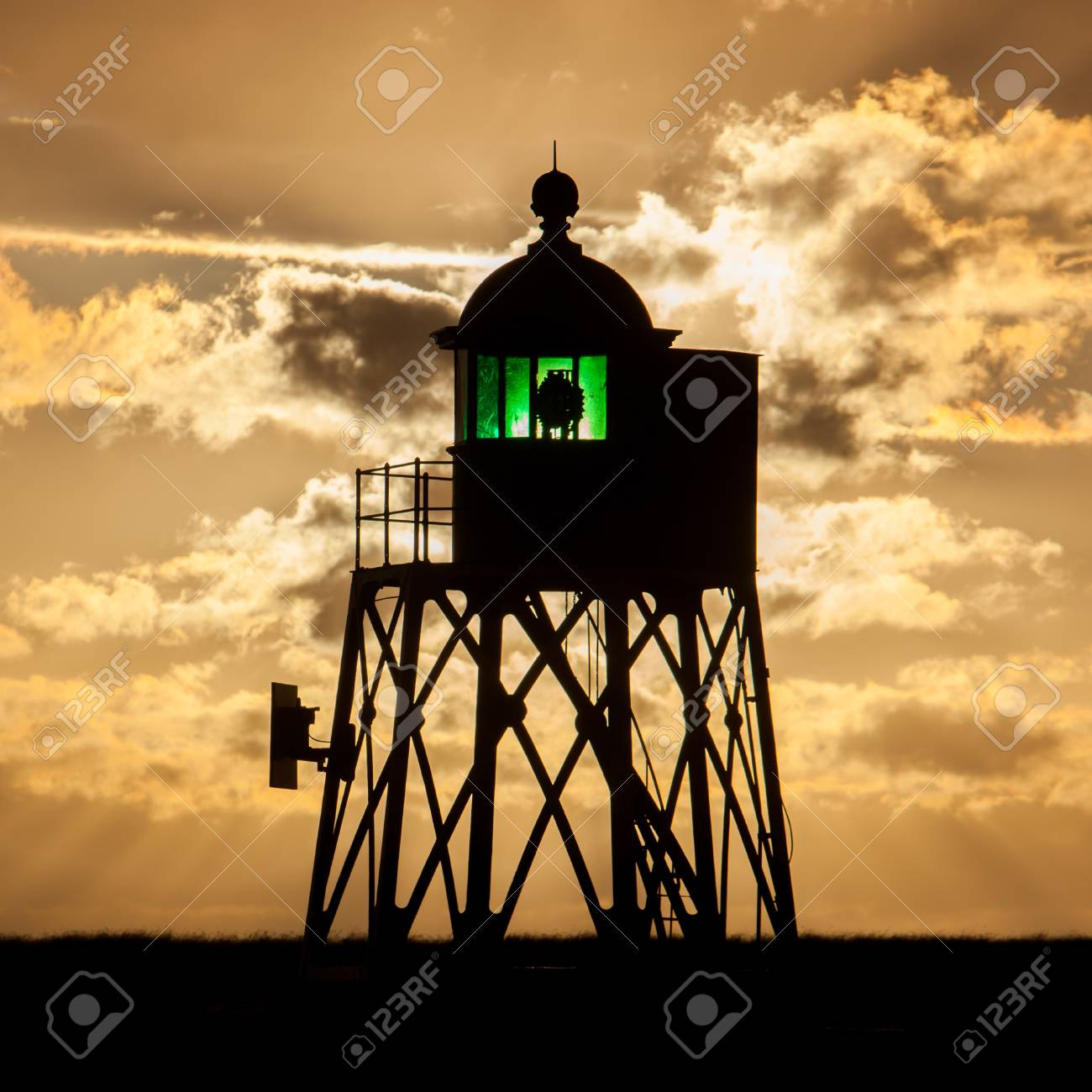 Silhouette of a green beacon at the dutch coast, sunset Stock Photo - 20488572