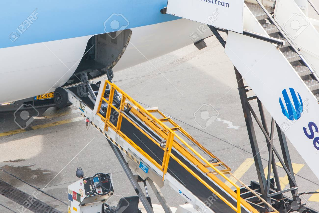 AMSTERDAM - SEPTEMBER 6: KLM plane is being loaded at Schiphol Airport Sept 6, 2013 in Amsterdam, The Netherlands. The airport handles over 45 million passengers per year with almost 100 airlines flying from here. Stock Photo - 22516548