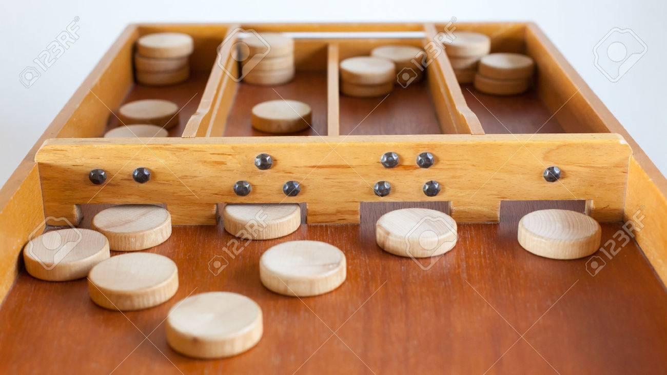Typical dutch wooden boardgame - Sjoelen - Selective focus Stock Photo - 26869478