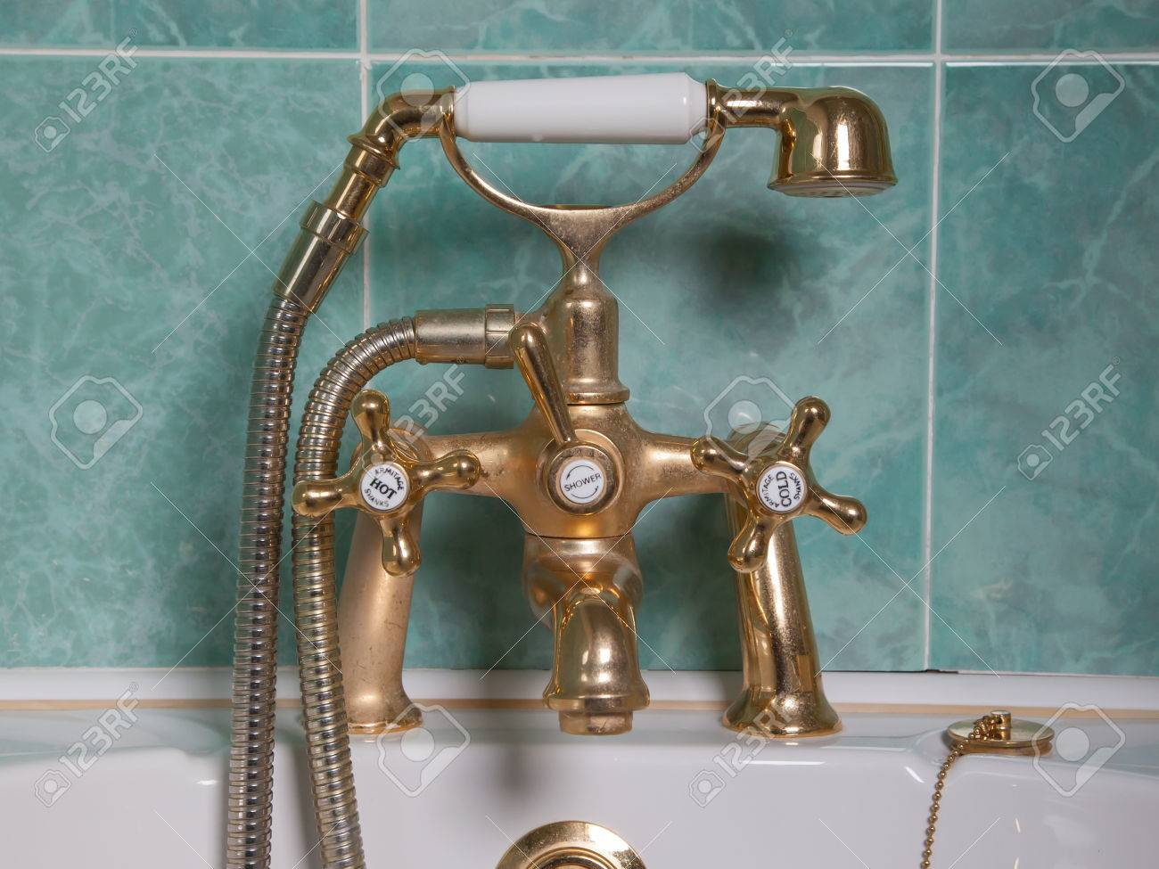 Vintage Bath Taps, Golden Tap With A Green Wall Stock Photo, Picture ...