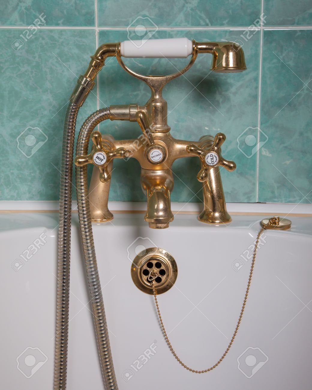 Vintage Bath Taps, Golden Tap With A Green Wall Stock Photo ...