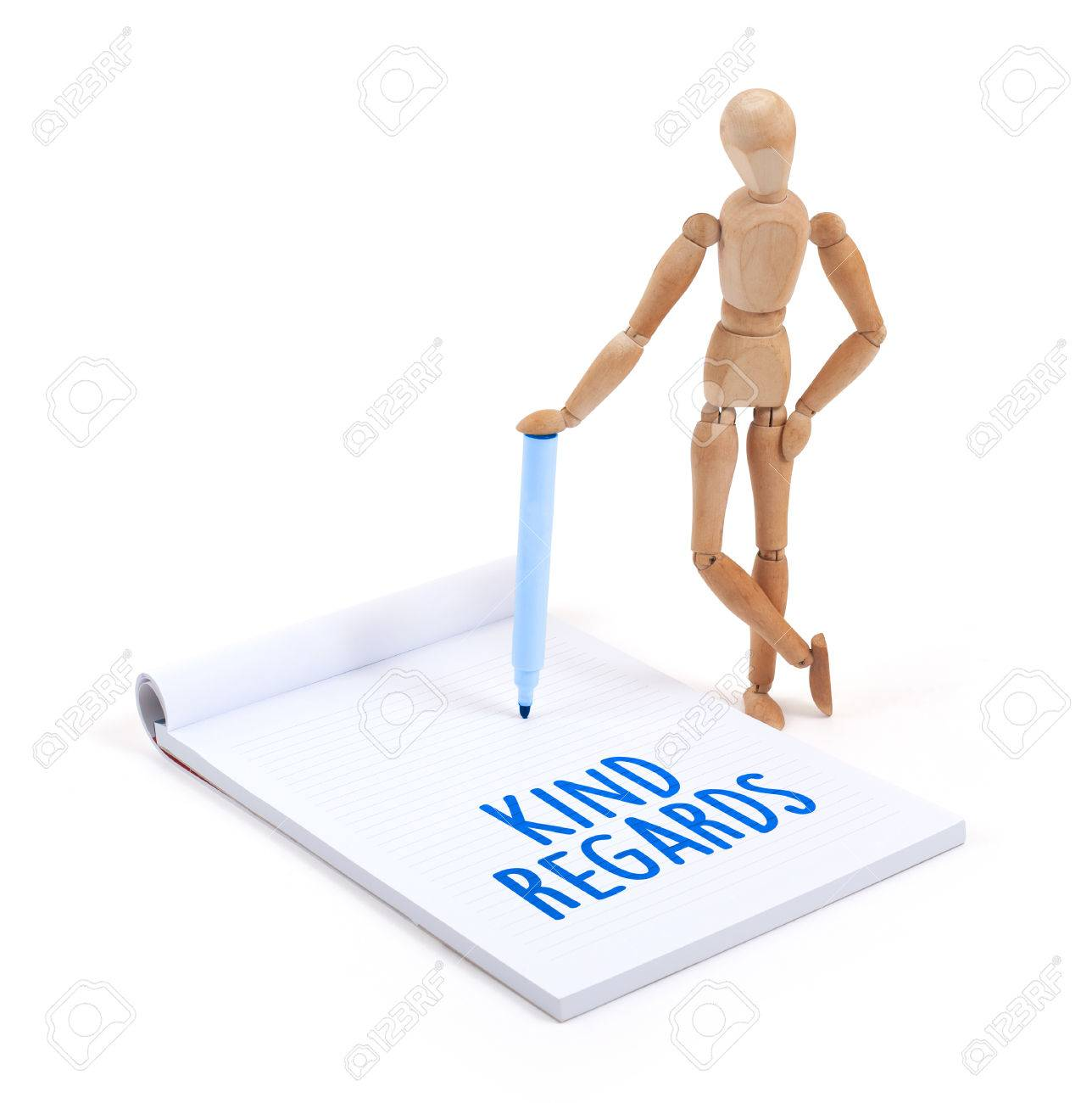 Wooden Mannequin Writing In A Scrapbook
