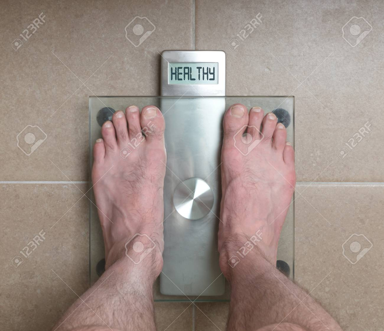 Closeup Of Mans Feet On Weight Scale Healthy Stock P O 82676779