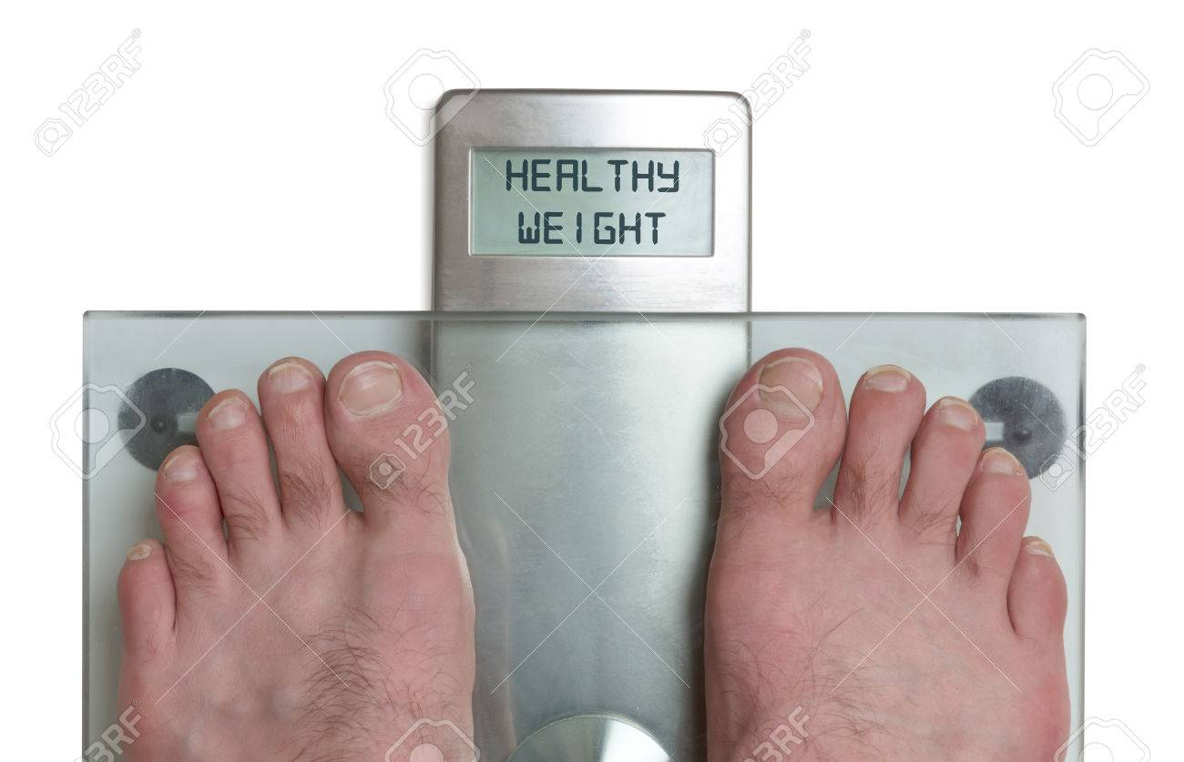 Closeup Of Mans Feet On Weight Scale Healthy Weight Stock P O 83135867