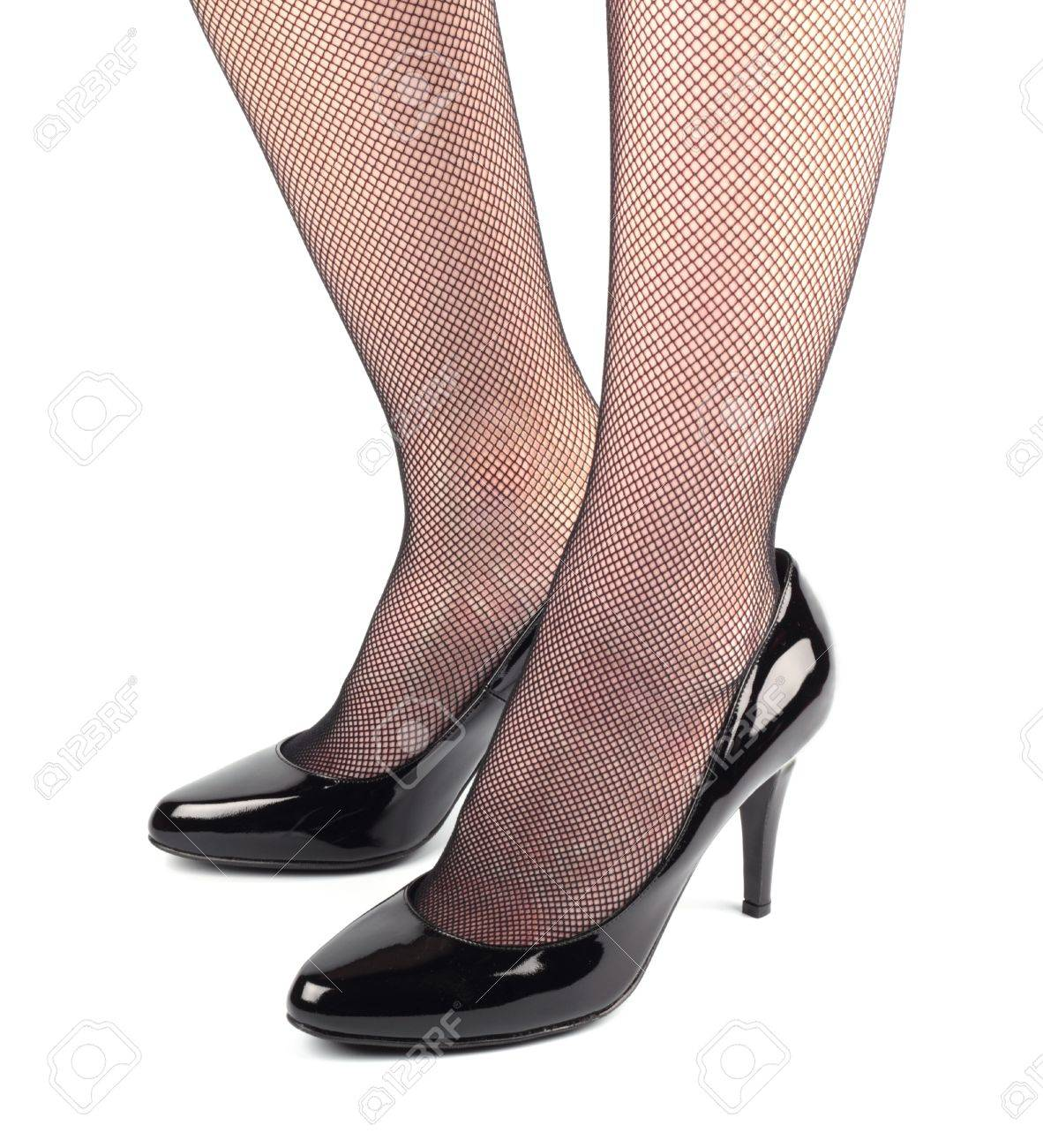 Stylish patent leather shoes girl legs in black patent leather female high heeled shoes isolated