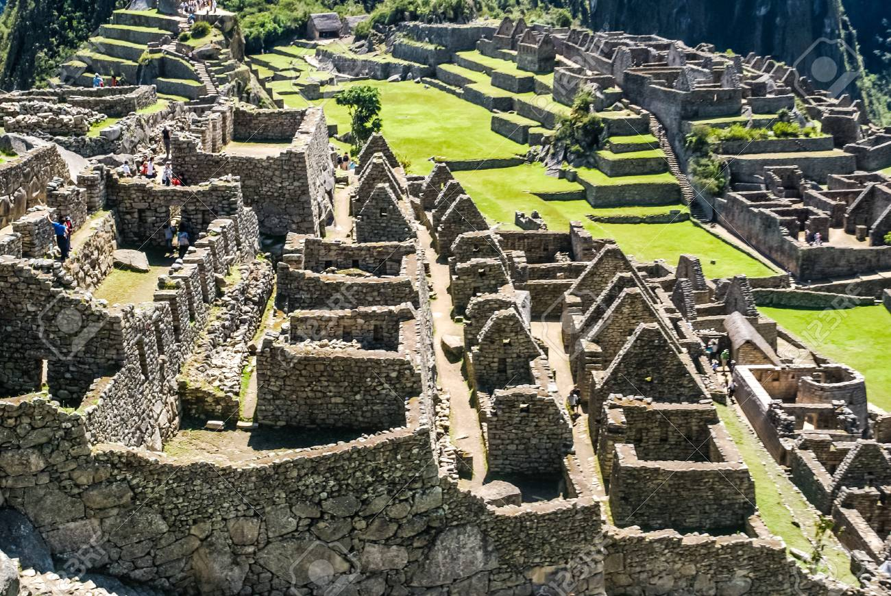 rest of old wrecked settlement surrounded by greenery near cuzco