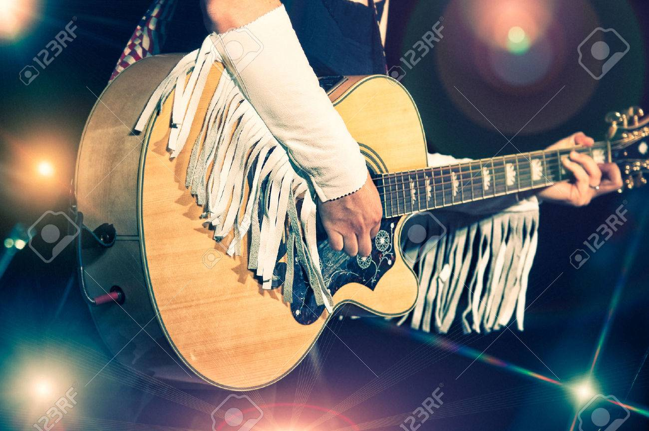 Woman guitarist in the country band - 34591485
