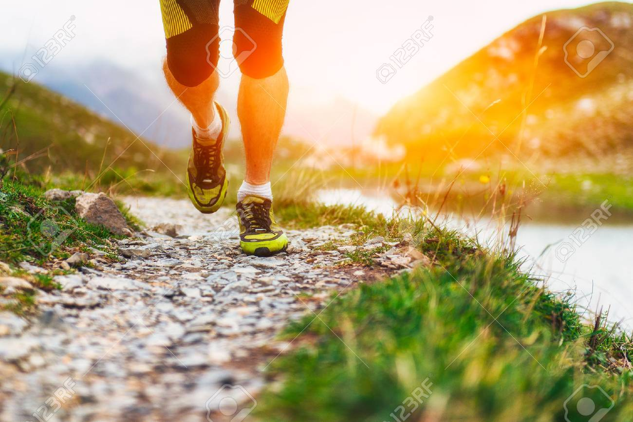 Particularly on the shoes of a runner in the mountains - 44623297