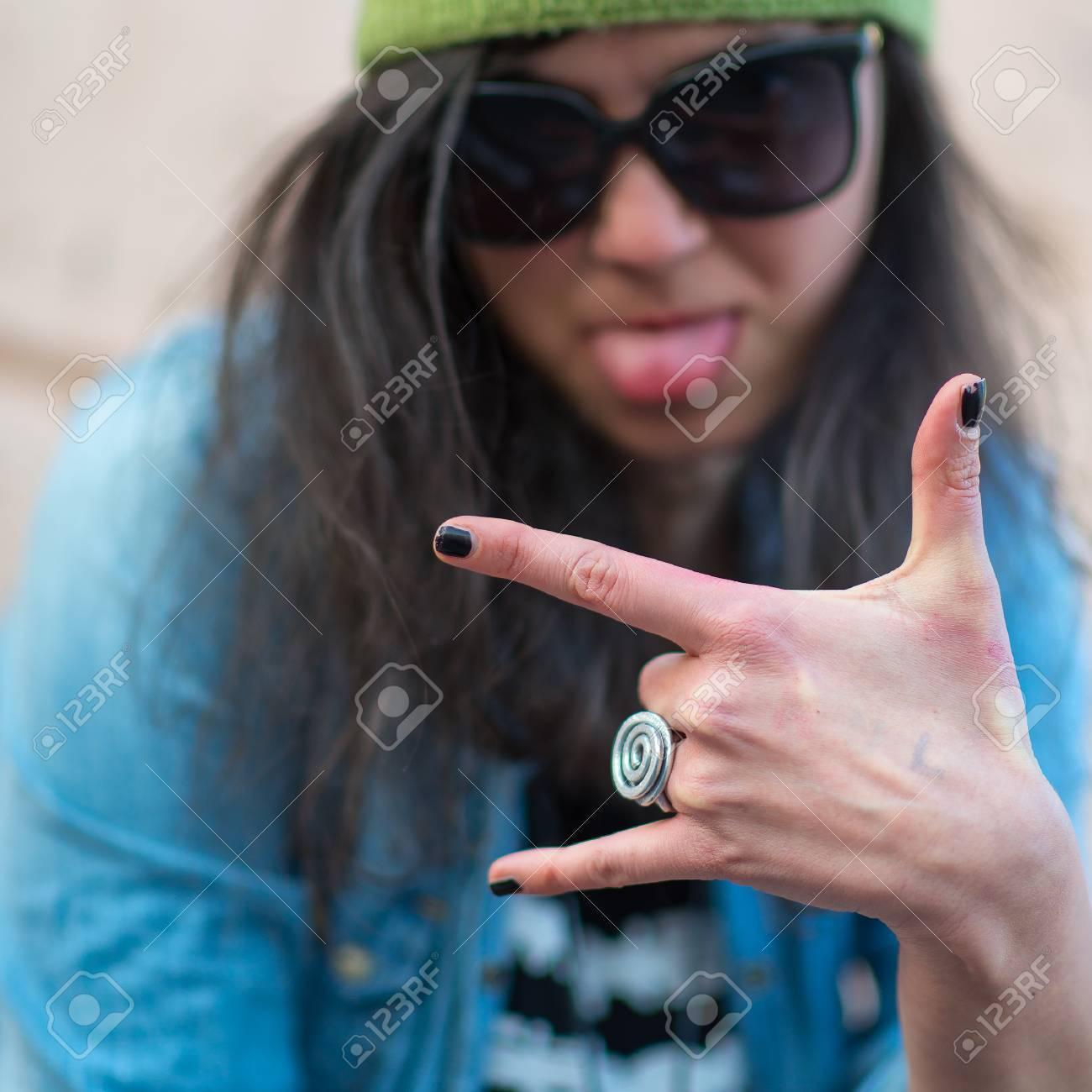 Hip hop rap girl with three fingers - 54848703