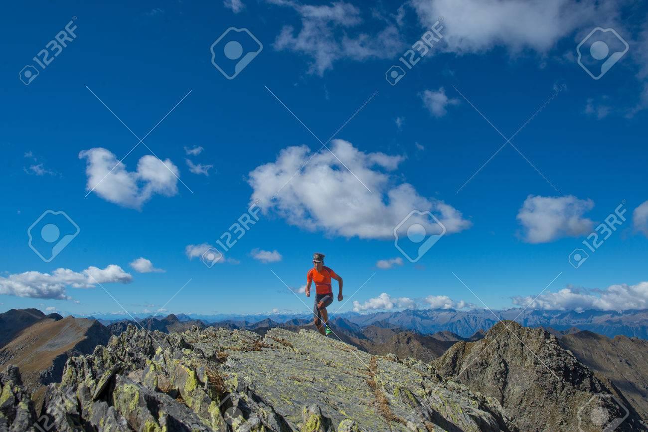 Man practice skyrunning in high mountain alone - 56098046