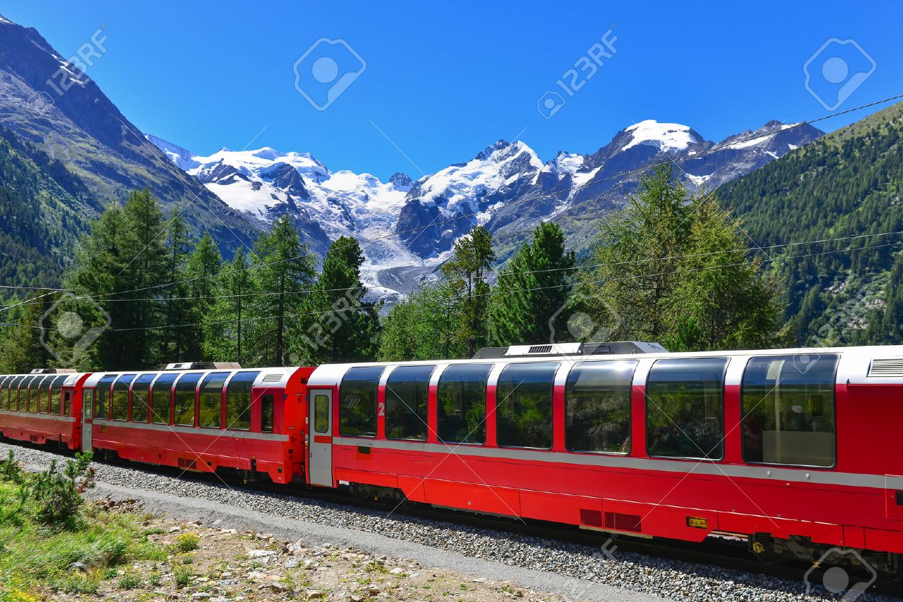 Swiss mountain train Bernina Express crossed Alps with glaciers in the backgroundin the summer - 64502496