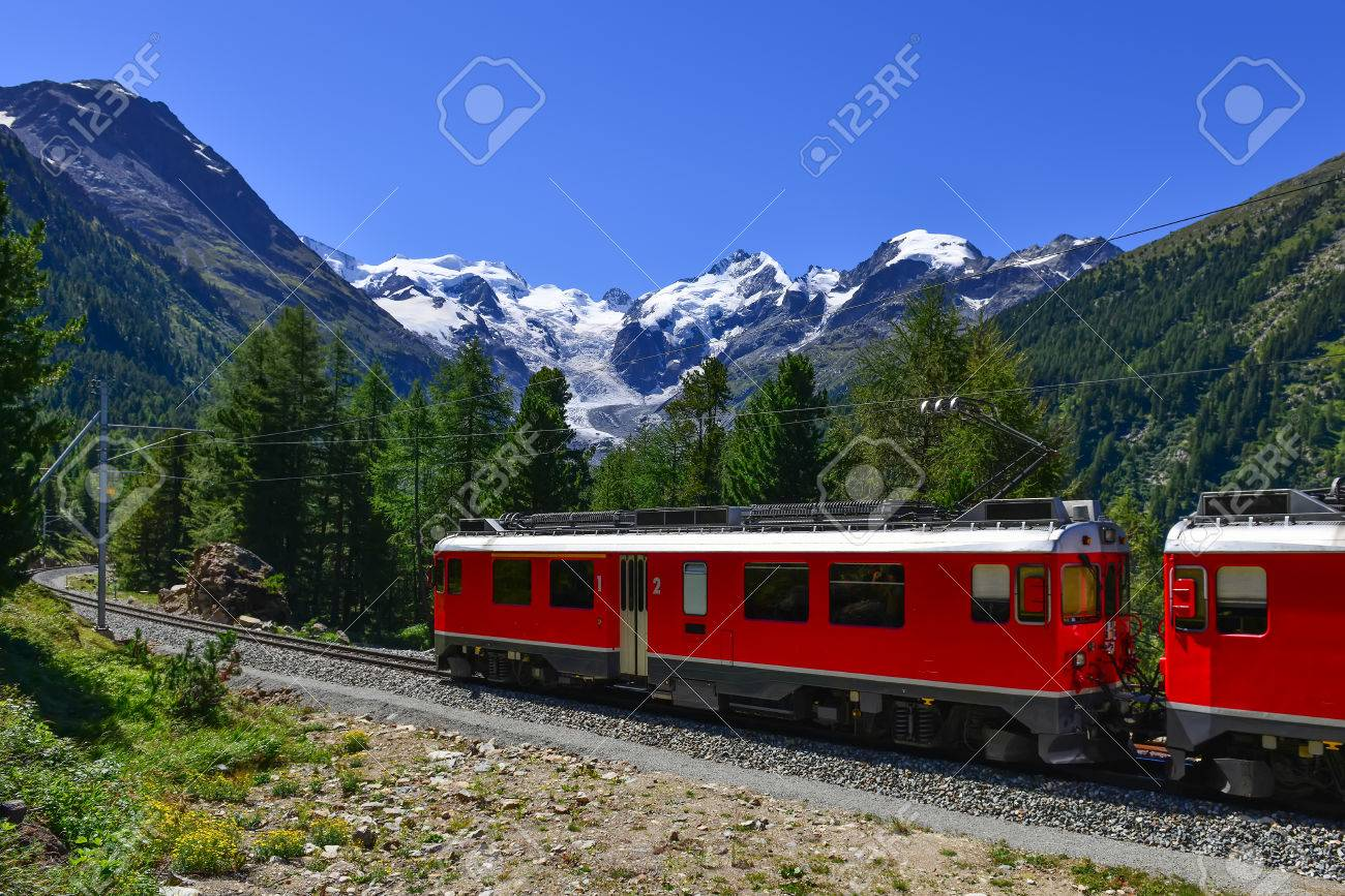 Swiss mountain train Bernina Express crossed Alps with glaciers in the backgroundin the summer - 64502498