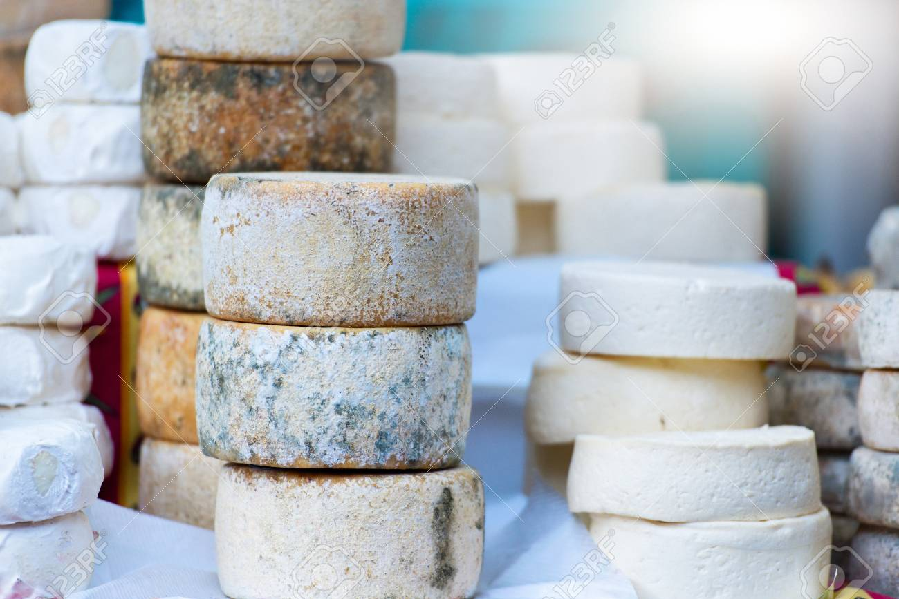 Traditional artisan cheese wheels composition. - 86584281