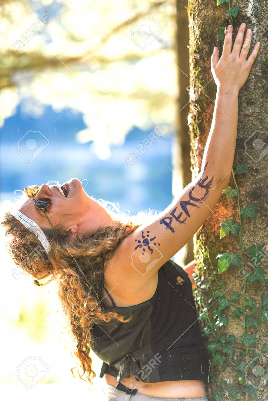 pretty free hippie girl laughing peace body painting outdoor