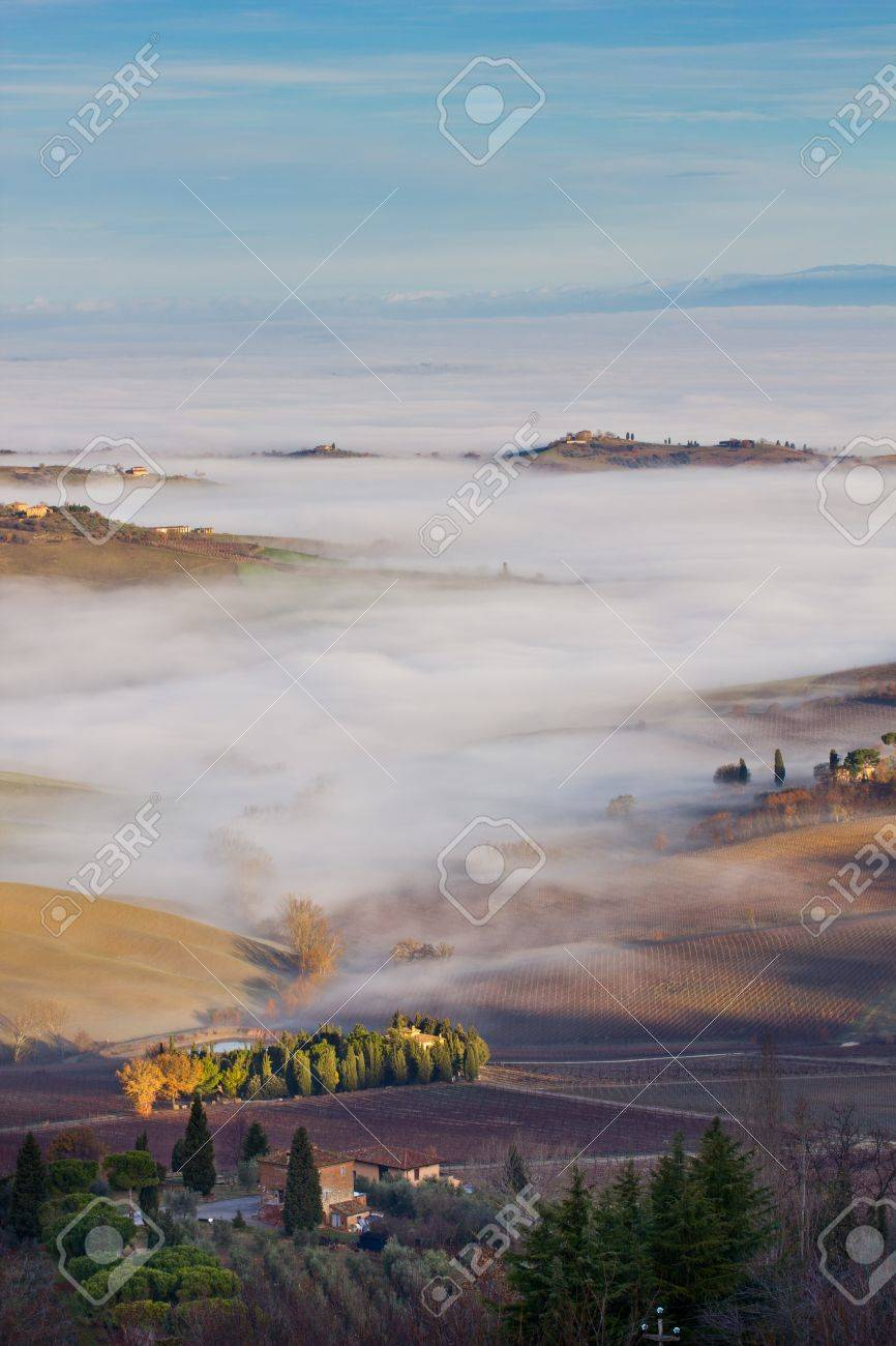 Tuscan landscape in the fog, Montepulciano (Italy). Stock Photo - 12124718