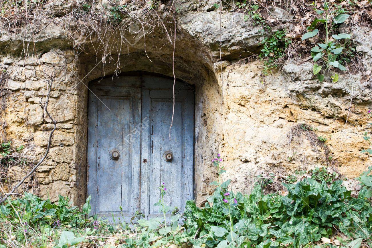 Beautiful Entrance Door To Old Cave Used As A Warehouse. Stock Photo   13654846