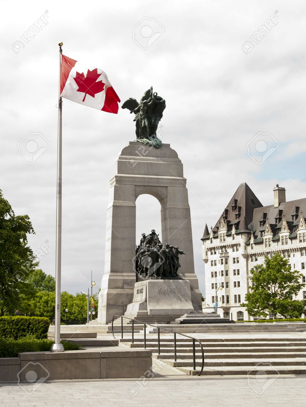 The National War Memorial With Canadian Flag And The Fairmont ...