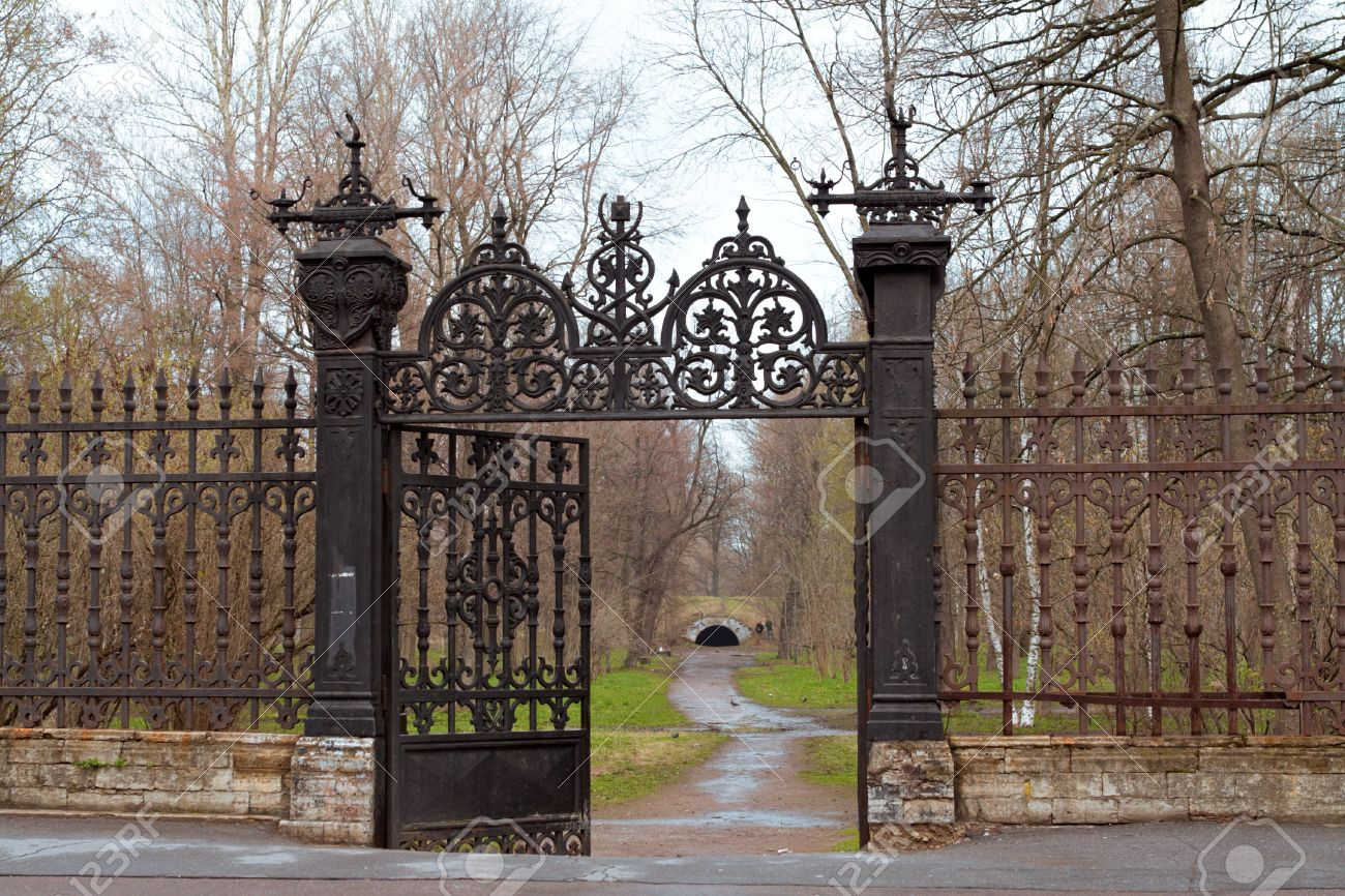 Old gate to perk with metal pattern Stock Photo - 7172927