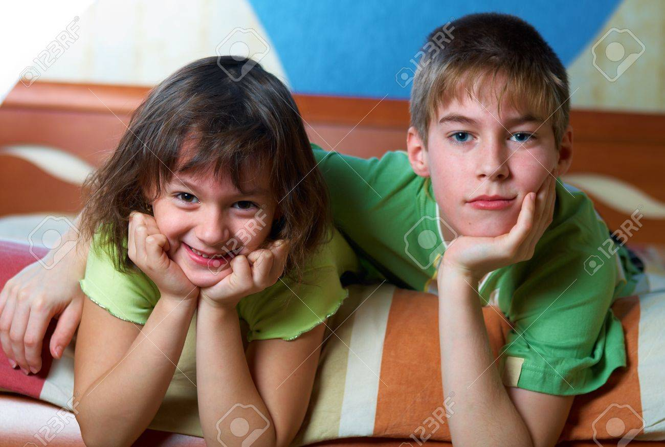 Children lying on their bellies in a bedroom Stock Photo - 12843740