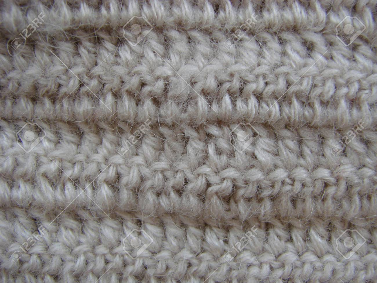 6ebbf4a0085f2 Stock Photo - Winter Design. knitting wool texture background. knitted  fabric texture. Knitted jersey background with a relief pattern. Crochet.  copy space