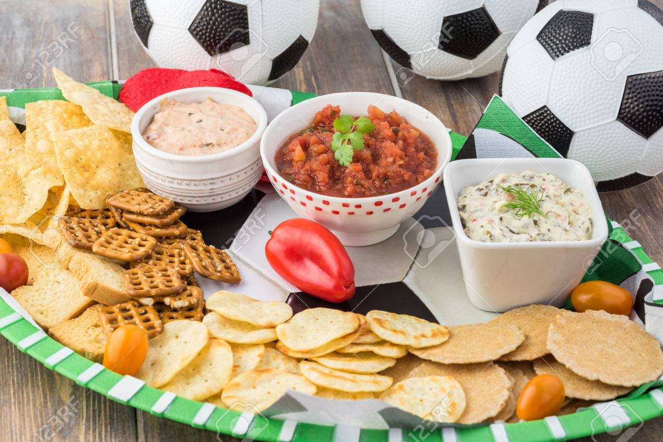 close up of party table for soccer game with variety of snacks