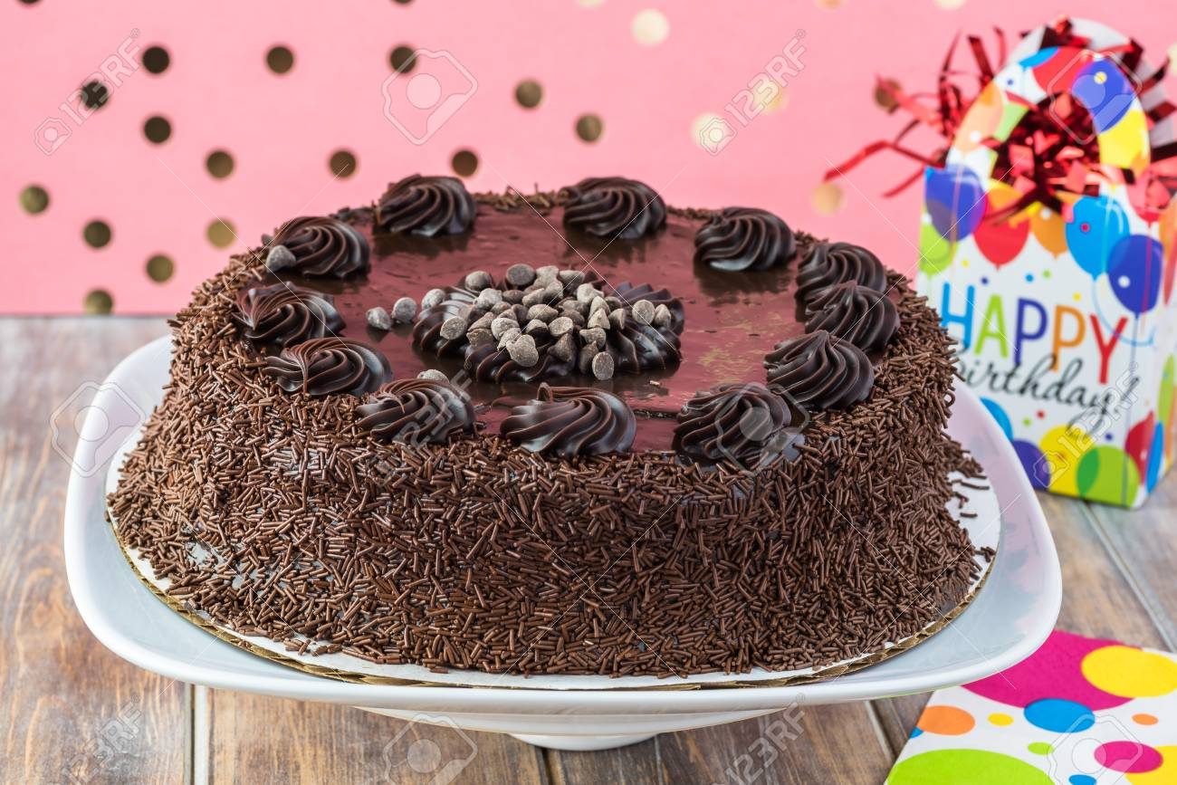 Close Up Of Chocolate Birthday Cake On A Cake Plate Stock Photo