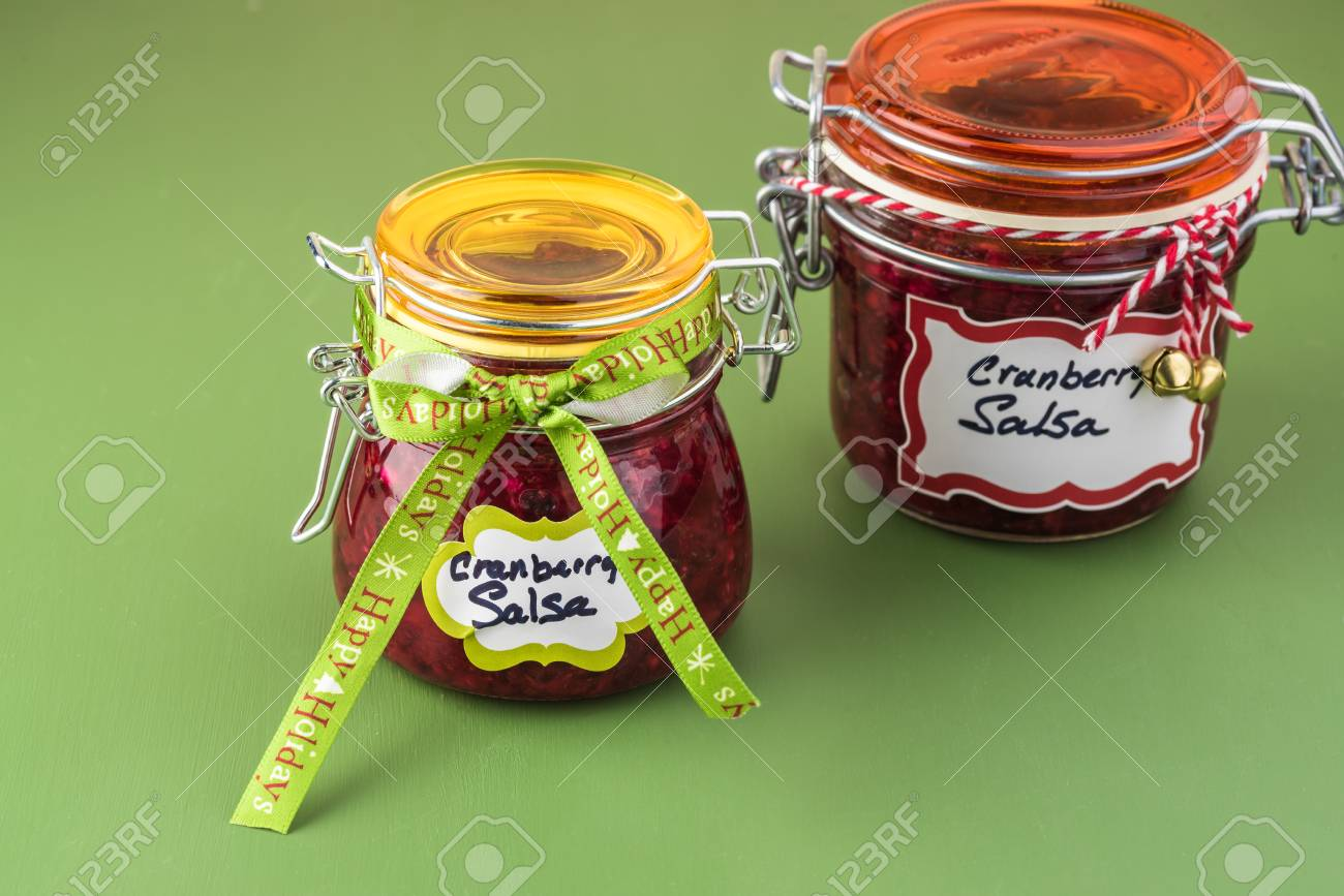 close up of jars with fresh homemade cranberry salsa decorated