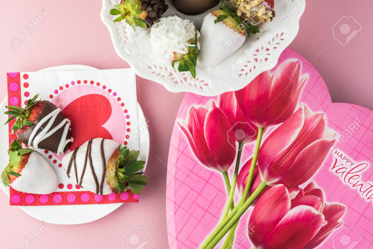 Close Up Of Chocolate Covered Strawberries On A Plate And Candy