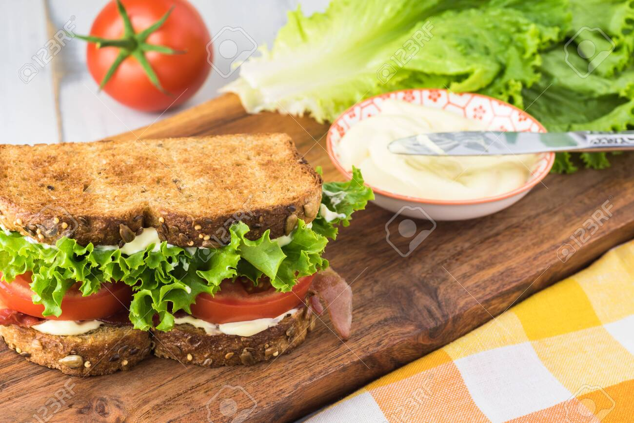 Close up of BLT sandwich with bacon, tomatoes, lettuce and myonnaise. - 129704454