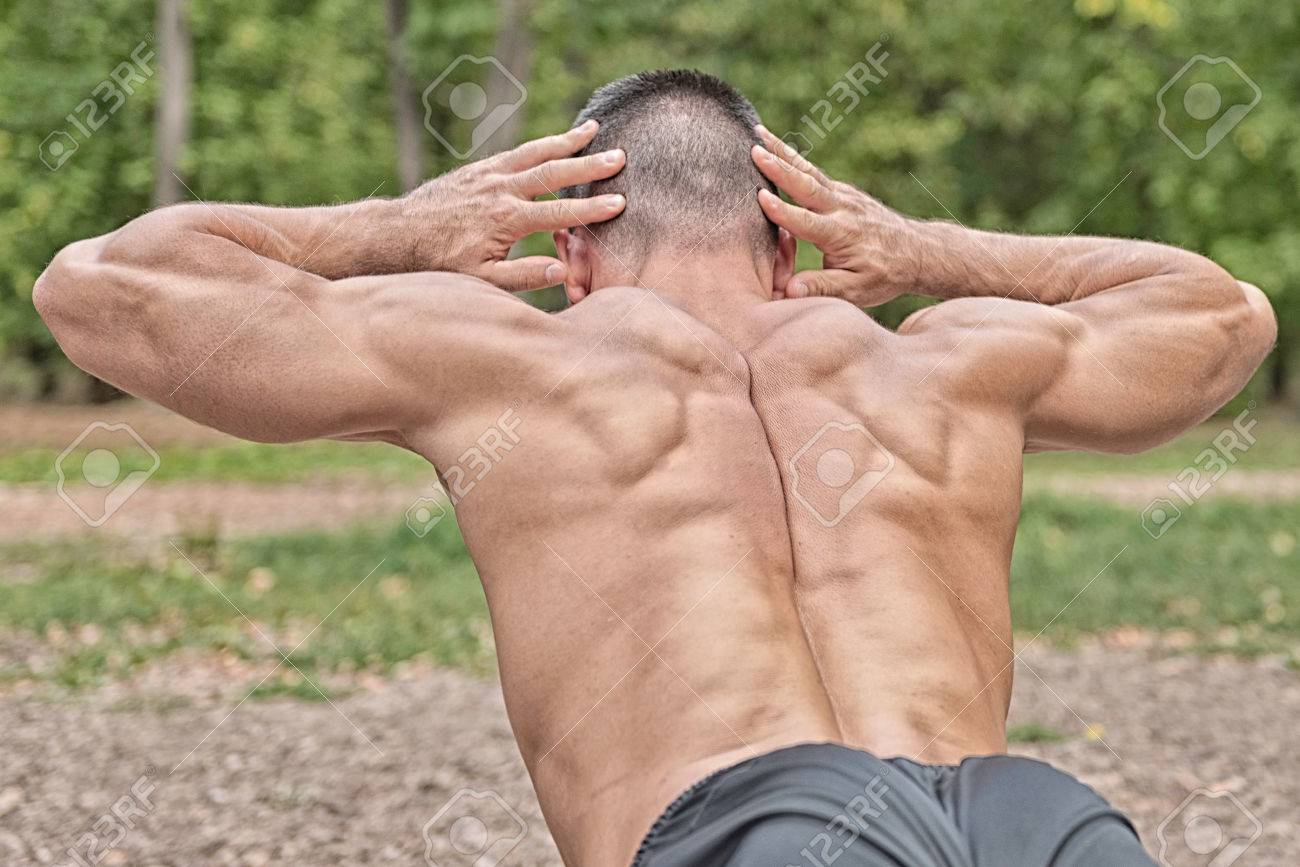Muscular Man Doing Lower Back Exercise Stock Photo Picture And